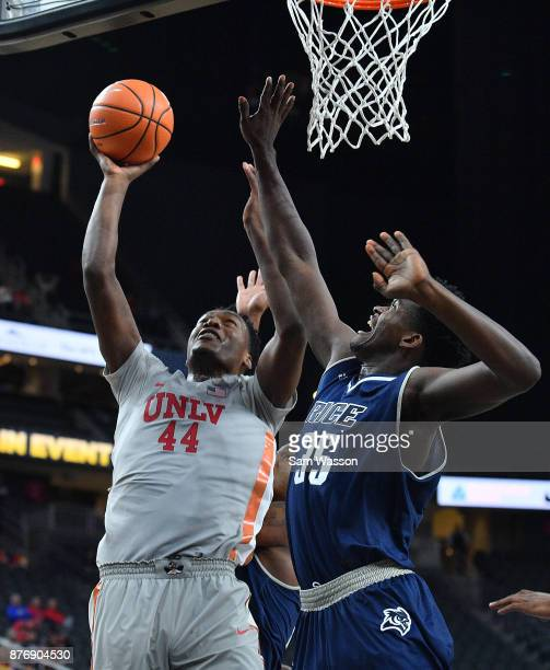 Brandon McCoy of the UNLV Rebels shoots against Tim Harrison of the Rice Owls during day one of the Main Event basketball tournament at TMobile Arena...