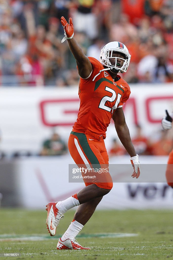 Brandon McGee #21 of the Miami Hurricanes celebrates after recovering a muffed punt by the South Florida Bulls on November 17, 2012 at Sun Life Stadium in Miami Gardens, Florida. The Hurricanes defeated the Bulls 40-9.