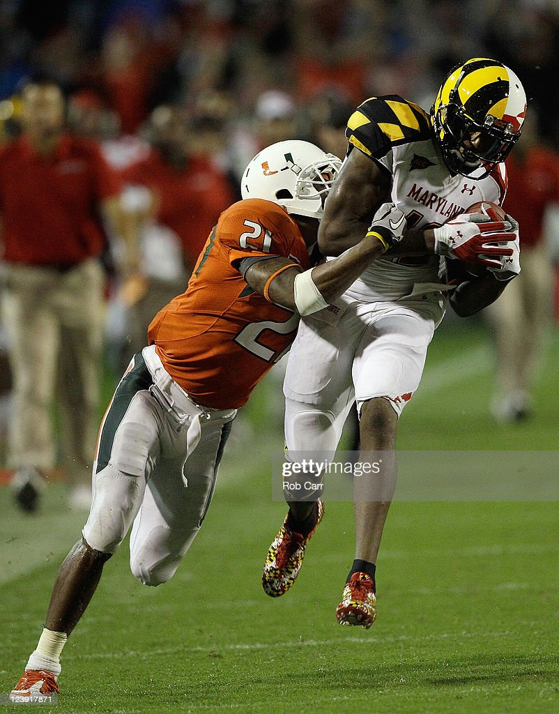 Brandon McGee #21 of the Miami Hurricanes tackles wide receiver Kevin Dorsey #12 of the Maryland Terrapins after catching a pass during the second half at Byrd Stadium on September 5, 2011 in College Park, Maryland. Maryland won 32-24.