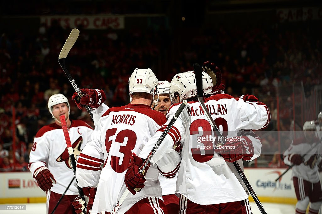 <a gi-track='captionPersonalityLinkClicked' href=/galleries/search?phrase=Brandon+McMillan&family=editorial&specificpeople=4556376 ng-click='$event.stopPropagation()'>Brandon McMillan</a> #38 of the Phoenix Coyotes celebrates with his teammates after scoring a goal in the first period during an NHL game against the Washington Capitals at Verizon Center on March 8, 2014 in Washington, DC.
