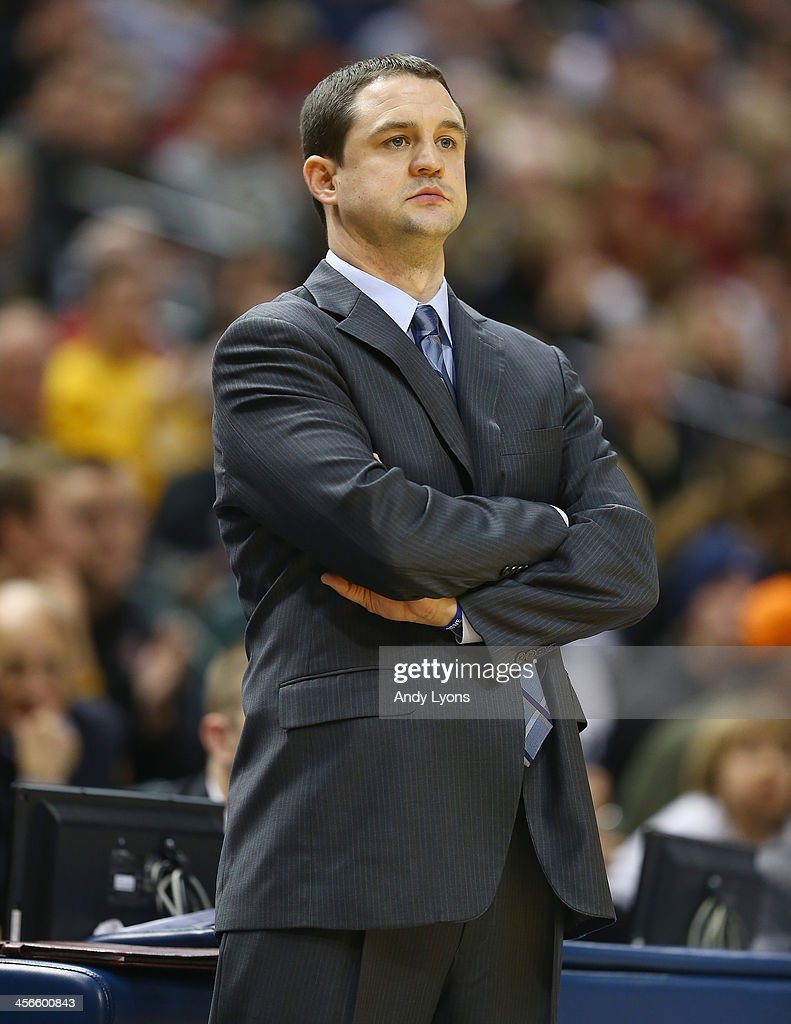 Brandon Miller the head coach of the Butler Bulldogs gives instructions to his team in the game against Purdue Boilermakers during the 2013 Crossroads Classic at Bankers Life Fieldhouse on December 14, 2013 in Indianapolis, Indiana.