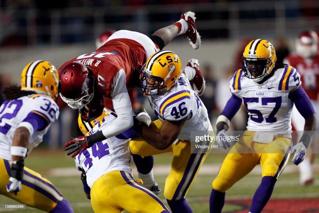 <a gi-track='captionPersonalityLinkClicked' href=/galleries/search?phrase=Brandon+Mitchell&family=editorial&specificpeople=2206857 ng-click='$event.stopPropagation()'>Brandon Mitchell</a> #17 of the Arkansas Razorbacks is tackled by Micah Eugene #34 and Kevin Minter #46 of the LSU Tigers at Razorback Stadium on November 23, 2012 in Fayetteville, Arkansas. The Tigers defeated the Razorbacks 20-13.