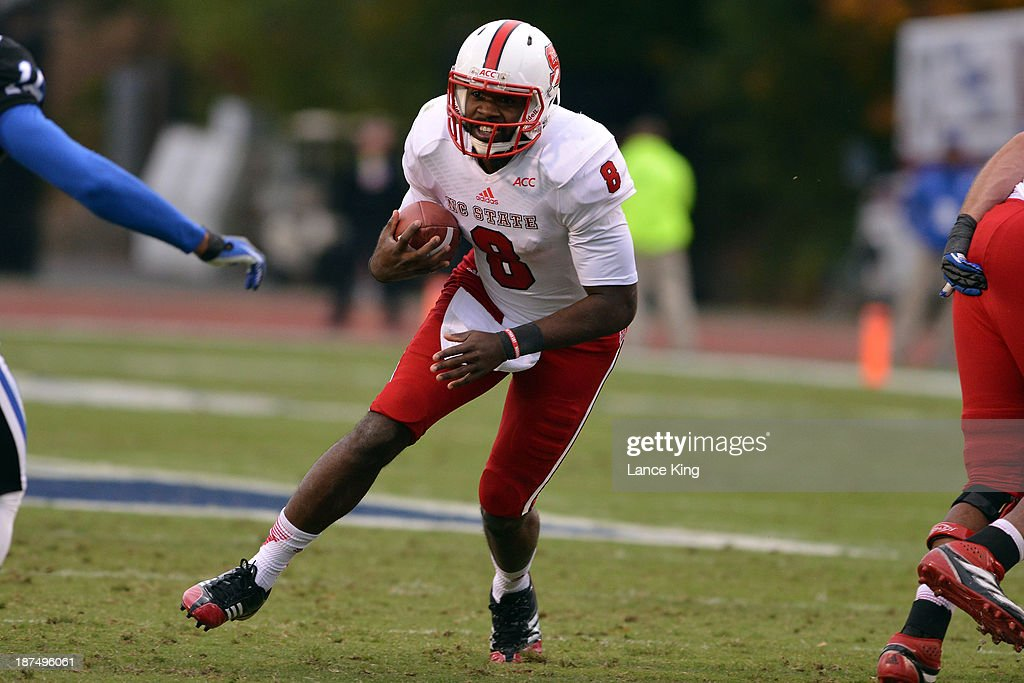 <a gi-track='captionPersonalityLinkClicked' href=/galleries/search?phrase=Brandon+Mitchell&family=editorial&specificpeople=2206857 ng-click='$event.stopPropagation()'>Brandon Mitchell</a> #8 of the North Carolina State Wolfpack runs with the ball against the Duke Blue Devils at Wallace Wade Stadium on November 9, 2013 in Durham, North Carolina.