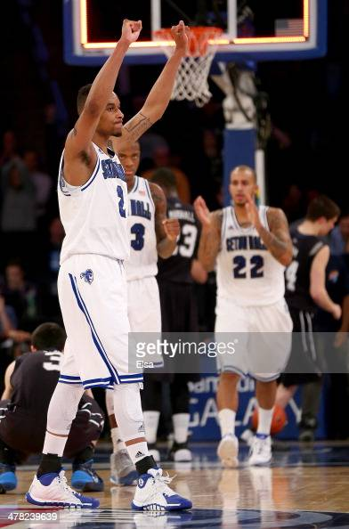 Brandon Mobley of the Seton Hall Pirates celebrates the win with teammates Fuquan Edwin and Brian Oliver after the game against the Butler Bulldogs...