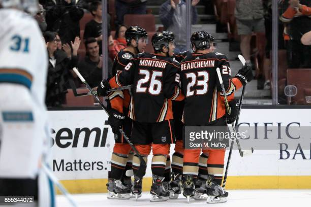 Brandon Montour Francois Beauchemin and Nick Ritchie congratulate Chris Wagner of the Anaheim Ducks after he scored a goal during the third period of...