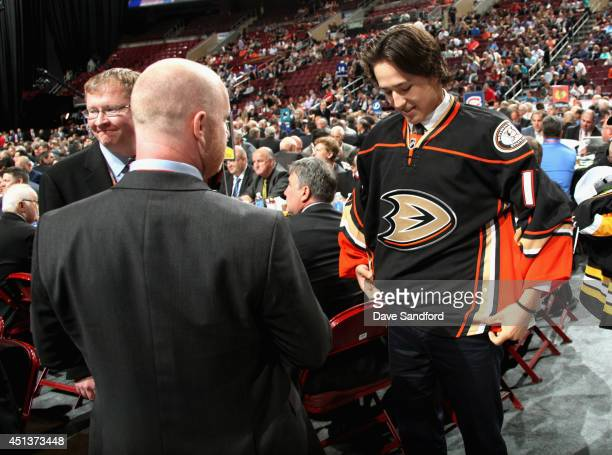 Brandon Montour greets his team after being selected 55th overall by the Anaheim Ducks during the 2014 NHL Entry Draft at Wells Fargo Center on June...