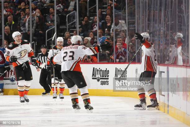 Brandon Montour of the Anaheim Ducks celebrates a goal against the Colorado Avalanche with teammate Francois Beauchemin at the Pepsi Center on...