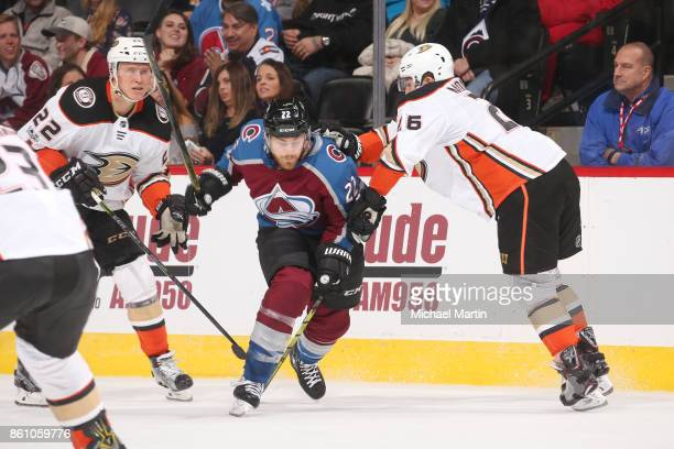 Brandon Montour of the Anaheim Ducks fights for position against Colin Wilson of the Colorado Avalanche at the Pepsi Center on October 13 2017 in...