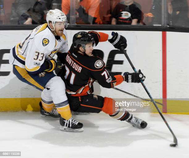 Brandon Montour of the Anaheim Ducks handles the puck against Colin Wilson of the Nashville Predators in Game Five of the Western Conference Final...