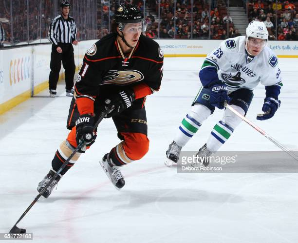 Brandon Montour of the Anaheim Ducks skates with the puck against Bo Horvat of the Vancouver Canucks during the game on March 5 2017 at Honda Center...