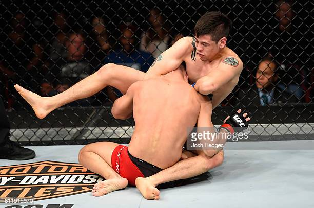 Brandon Moreno of Mexico attempts to submit Louis Smolka in their flyweight bout during the UFC Fight Night event at the Moda Center on October 1...