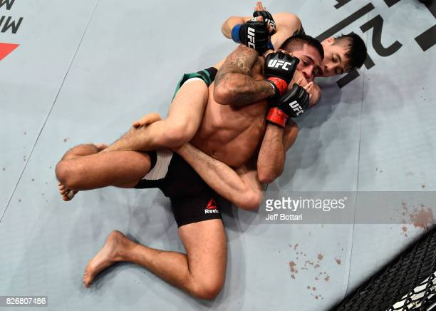 Brandon Moreno of Mexico attempts to submit Sergio Pettis in their flyweight bout during the UFC Fight Night event at Arena Ciudad de Mexico on...