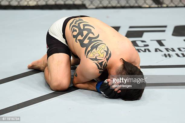 Brandon Moreno of Mexico celebrates after submitting Louis Smolka in their flyweight bout during the UFC Fight Night event at the Moda Center on...