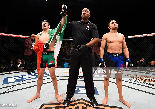 Brandon Moreno of Mexico celebrates his splitdecision victory over Ryan Benoit in their flyweight bout during The Ultimate Fighter Finale event...