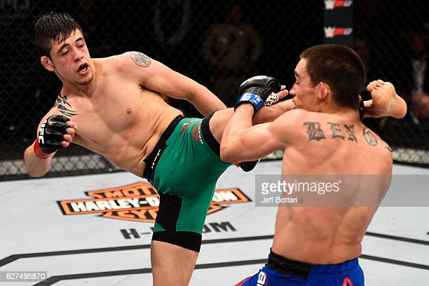 Brandon Moreno of Mexico kicks Ryan Benoit in their flyweight bout during The Ultimate Fighter Finale event inside the Pearl concert theater at the...