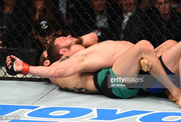 Brandon Moreno of Mexico secures a rear choke submission against Dustin Ortiz in their flyweight bout during the UFC Fight Night event at Bridgestone...