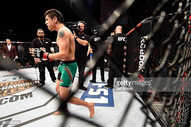 Brandon Moreno of Mexico stands in the Octagon prior to his flyweight bout against Ryan Benoit during The Ultimate Fighter Finale event inside the...