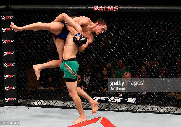 Brandon Moreno of Mexico takes down Ryan Benoit in their flyweight bout during The Ultimate Fighter Finale event inside the Pearl concert theater at...