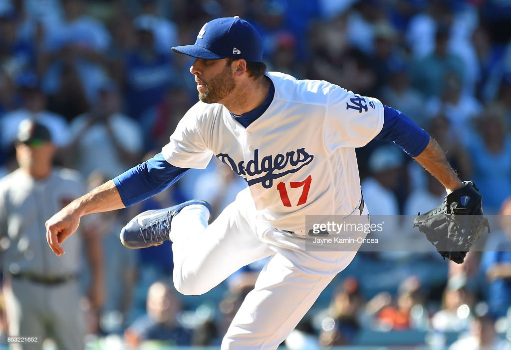 Brandon Morrow #17 of the Los Angeles Dodgers pitches for a save in the ninth inning of the game against the San Francisco Giants at Dodger Stadium on September 24, 2017 in Los Angeles, California.