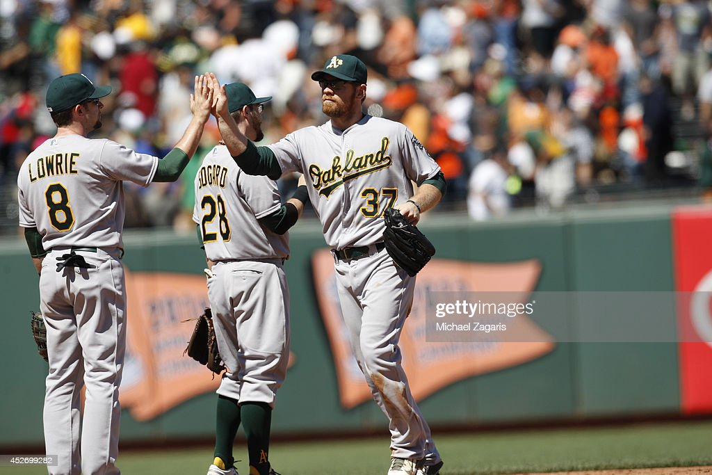 <a gi-track='captionPersonalityLinkClicked' href=/galleries/search?phrase=Brandon+Moss&family=editorial&specificpeople=702783 ng-click='$event.stopPropagation()'>Brandon Moss</a> #37 and <a gi-track='captionPersonalityLinkClicked' href=/galleries/search?phrase=Jed+Lowrie&family=editorial&specificpeople=4949369 ng-click='$event.stopPropagation()'>Jed Lowrie</a> #8 of the Oakland Athletics celebrate on the field following the game against the San Francisco Giants at AT&T Park on July 10, 2014 in San Francisco, California. The Athletics defeated the Giants 6-1.