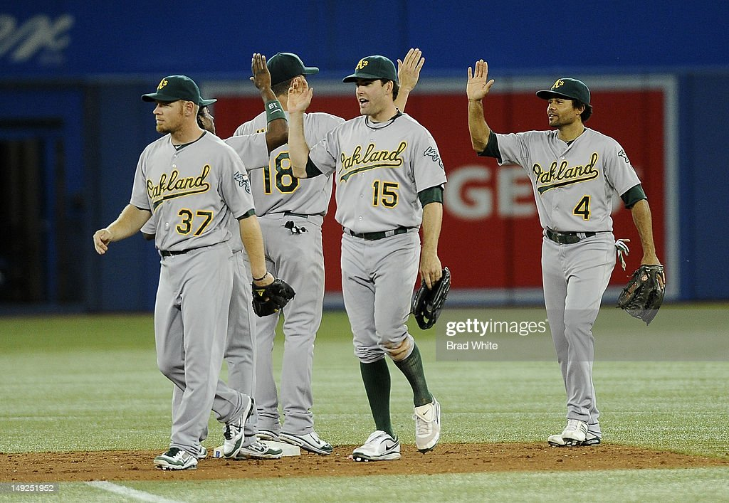 <a gi-track='captionPersonalityLinkClicked' href=/galleries/search?phrase=Brandon+Moss&family=editorial&specificpeople=702783 ng-click='$event.stopPropagation()'>Brandon Moss</a> #37, Brandon Hicks #18, <a gi-track='captionPersonalityLinkClicked' href=/galleries/search?phrase=Seth+Smith&family=editorial&specificpeople=3190174 ng-click='$event.stopPropagation()'>Seth Smith</a> #15 and <a gi-track='captionPersonalityLinkClicked' href=/galleries/search?phrase=Coco+Crisp&family=editorial&specificpeople=206376 ng-click='$event.stopPropagation()'>Coco Crisp</a> #4 of the Oakland Athletics celebrate the team's win over the Toronto Blue Jays during MLB game action July 25, 2012 at Rogers Centre in Toronto, Ontario, Canada.