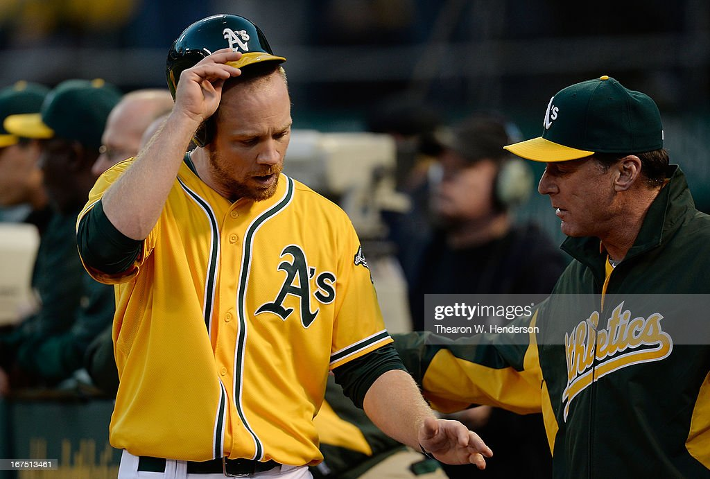 <a gi-track='captionPersonalityLinkClicked' href=/galleries/search?phrase=Brandon+Moss&family=editorial&specificpeople=702783 ng-click='$event.stopPropagation()'>Brandon Moss</a> #37 of the Oakland Athleitcs is congratulated by manager <a gi-track='captionPersonalityLinkClicked' href=/galleries/search?phrase=Bob+Melvin&family=editorial&specificpeople=239192 ng-click='$event.stopPropagation()'>Bob Melvin</a> #6 after Moss scored on a Josh Donaldson two-run double against the Baltimore Orioles in the second inning at O.co Coliseum on April 25, 2013 in Oakland, California.