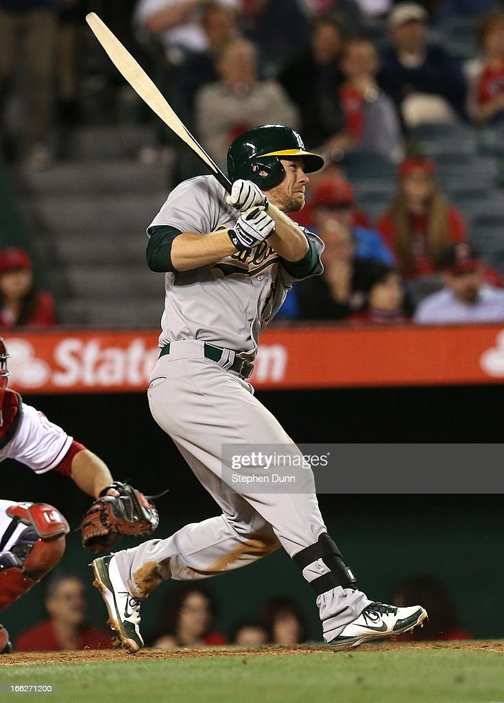 Brandon Moss #37 of the Oakland Athletics breaks his bat as he hits an RBI single in the seventh inning against the Los Angeles Angels of Anaheim at Angel Stadium of Anaheim on April 10, 2013 in Anaheim, California.