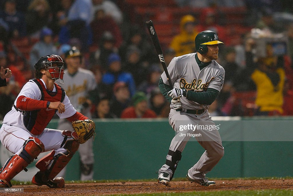 Brandon Moss #37 of the Oakland Athletics connects to knock in two runs against Alfredo Aceves #91 of the Boston Red Sox in the 3rd inning at Fenway Park on April 23, 2013 in Boston, Massachusetts.