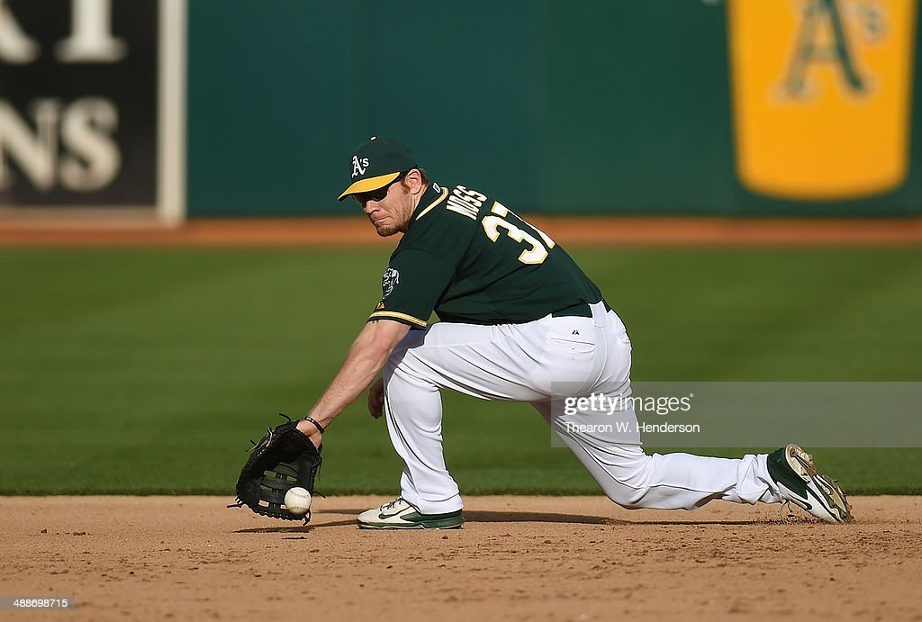 <a gi-track='captionPersonalityLinkClicked' href=/galleries/search?phrase=Brandon+Moss&family=editorial&specificpeople=702783 ng-click='$event.stopPropagation()'>Brandon Moss</a> #37 of the Oakland Athletics goes down to his backhand to field a ground ball off the bat of Michael Saunders #55 of the Seattle Mariners (not pictured) in the top of the six inning during game two of a doubleheader at O.co Coliseum on May 7, 2014 in Oakland, California. The Athletics won the game 2-0.
