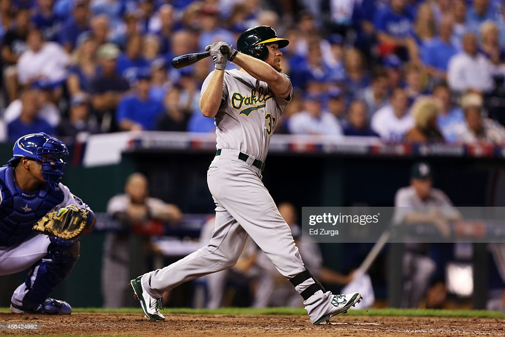 Brandon Moss of the Oakland Athletics hits a threerun home run in the sixth inning against the Kansas City Royals during the American League Wild...