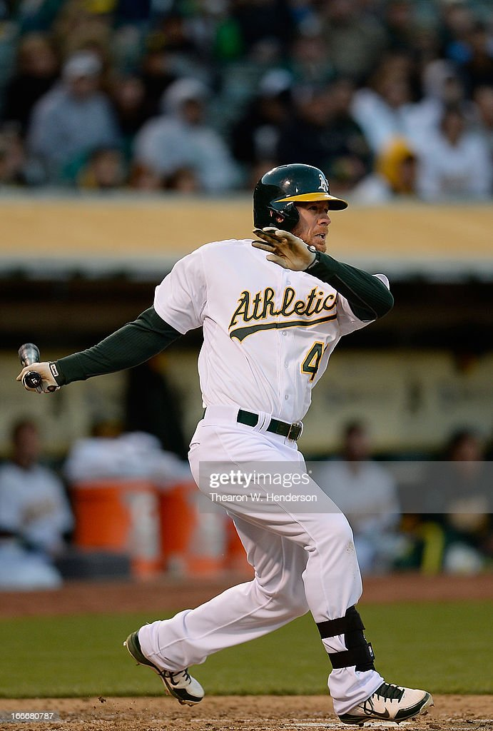 <a gi-track='captionPersonalityLinkClicked' href=/galleries/search?phrase=Brandon+Moss&family=editorial&specificpeople=702783 ng-click='$event.stopPropagation()'>Brandon Moss</a> of the Oakland Athletics hits a two run single against the Houston Astros in the first inning at O.co Coliseum on April 15, 2013 in Oakland, California. All uniformed team members are wearing jersey number 42 in honor of Jackie Robinson Day.