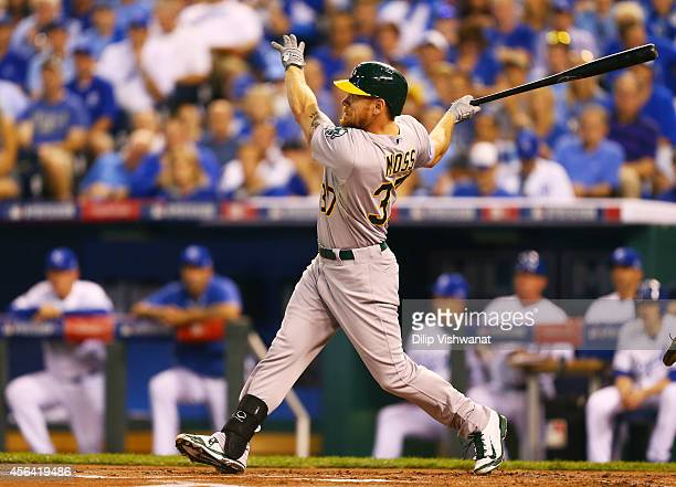 Brandon Moss of the Oakland Athletics hits a tworun home run in the first inning against the Kansas City Royals during the American League Wild Card...