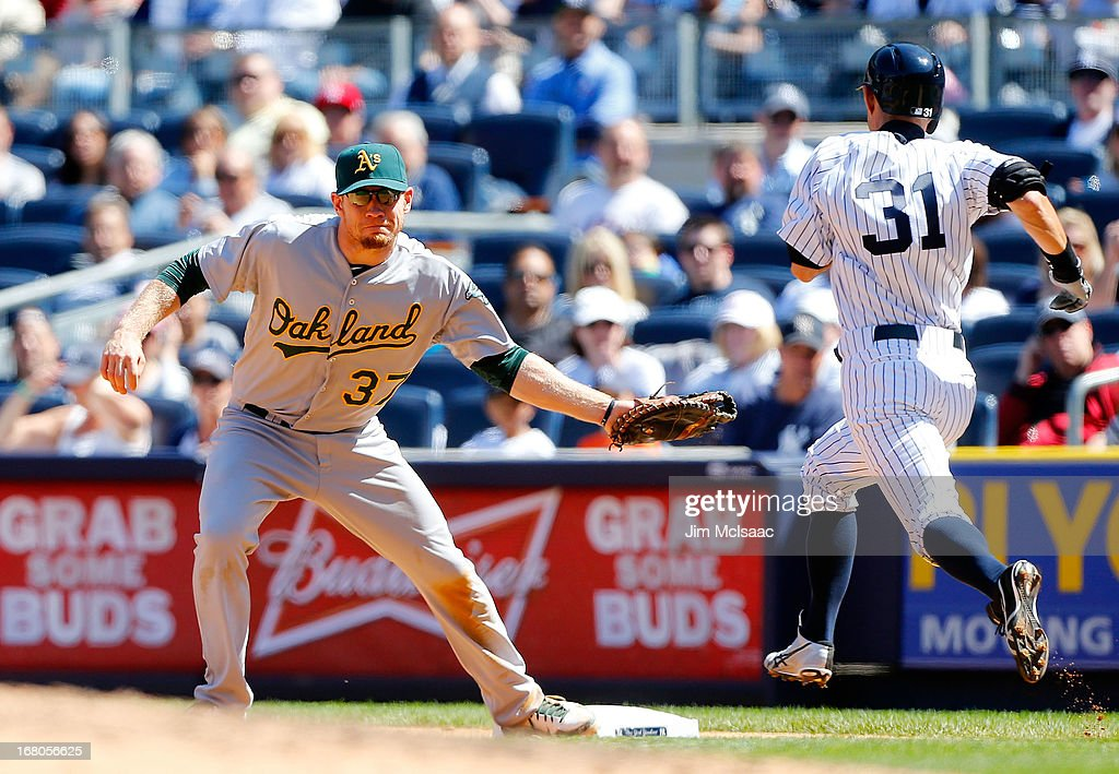 Brandon Moss #37 of the Oakland Athletics in action against Ichiro Suzuki #31 of the New York Yankees at Yankee Stadium on May 4, 2013 in the Bronx borough of New York City. The Yankees defeated the A's 4-2.