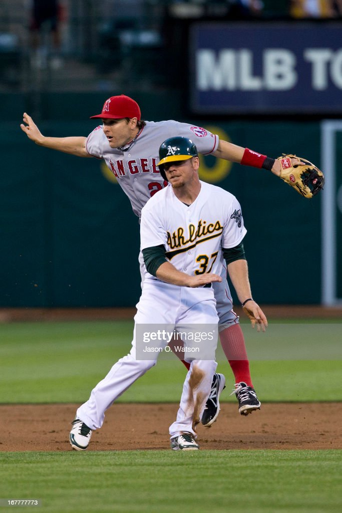 Brandon Moss #37 of the Oakland Athletics is allowed to advance to third base after being interfered in the base path by Brendan Harris #20 of the Los Angeles Angels of Anaheim during the second inning at O.co Coliseum on April 29, 2013 in Oakland, California.