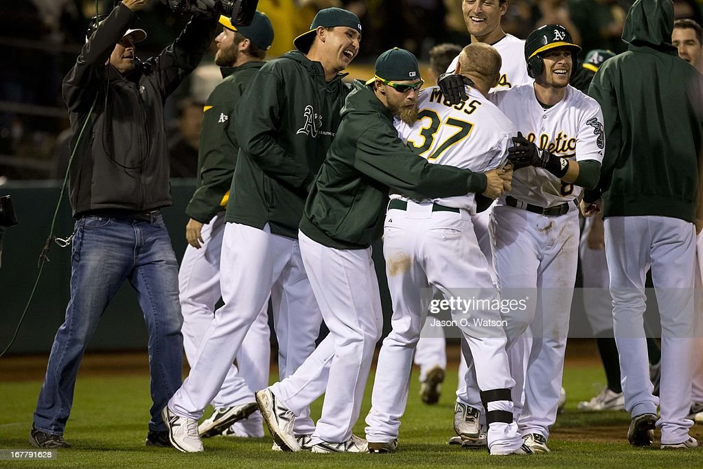 Brandon Moss #37 of the Oakland Athletics is congratulated by teammates after hitting a walk off two run home run against the Los Angeles Angels of Anaheim during the nineteenth inning at O.co Coliseum on April 30, 2013 in Oakland, California. The Oakland Athletics defeated the Los Angeles Angels of Anaheim 10-8 in 19 innings.