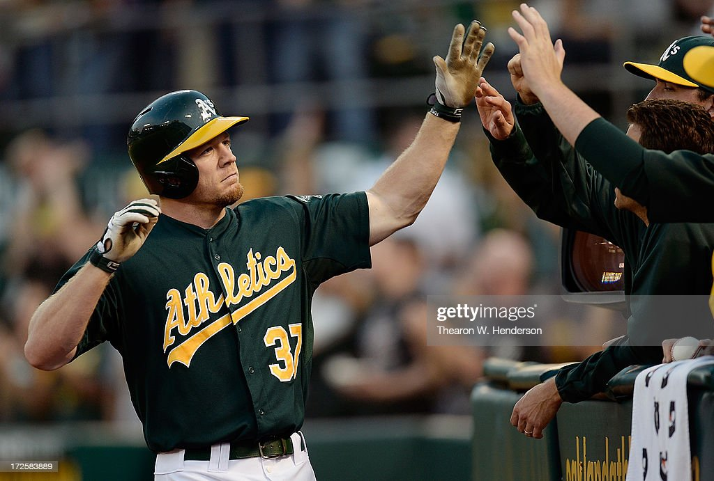 <a gi-track='captionPersonalityLinkClicked' href=/galleries/search?phrase=Brandon+Moss&family=editorial&specificpeople=702783 ng-click='$event.stopPropagation()'>Brandon Moss</a> #37 of the Oakland Athletics is congratulated by teammates after he hit a solo home run in the fourth inning against the Chicago Cubs at O.co Coliseum on July 3, 2013 in Oakland, California.