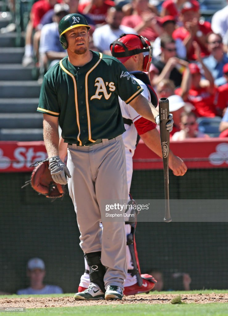 Brandon Moss #37 of the Oakland Athletics reacts after striking out swinging to end the sixth inning against the Los Angeles Angels of Anaheim at Angel Stadium of Anaheim on August 31, 2014 in Anaheim, California. The Angels won 8-1 to complete a four game sweep.