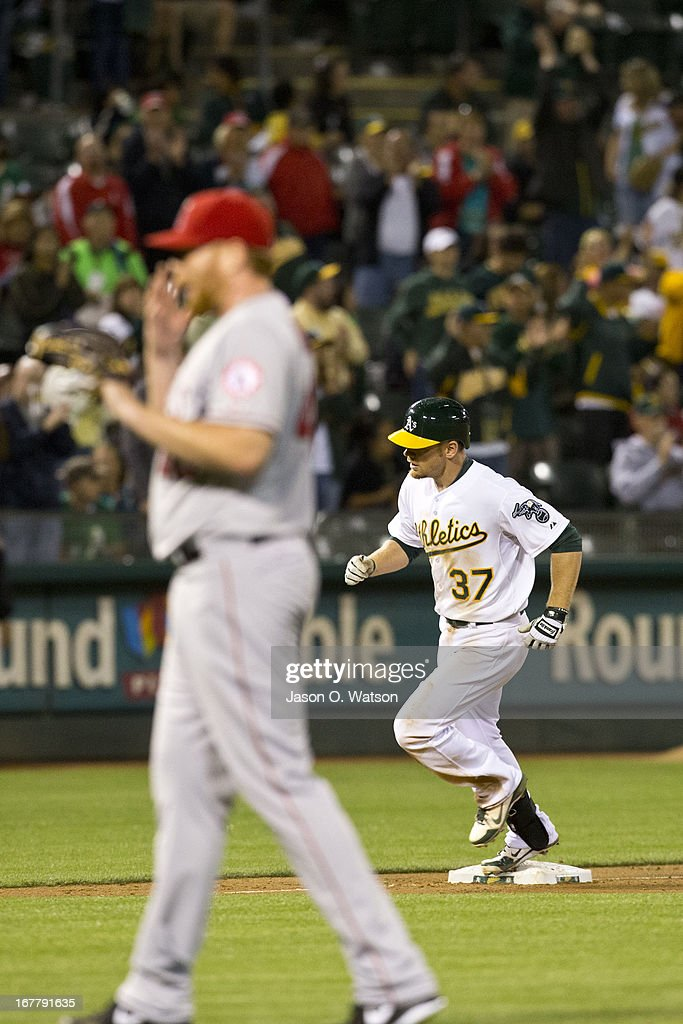 Brandon Moss #37 of the Oakland Athletics rounds the bases after hitting a home run off of Tommy Hanson #48 of the Los Angeles Angels of Anaheim during the sixth inning at O.co Coliseum on April 29, 2013 in Oakland, California.
