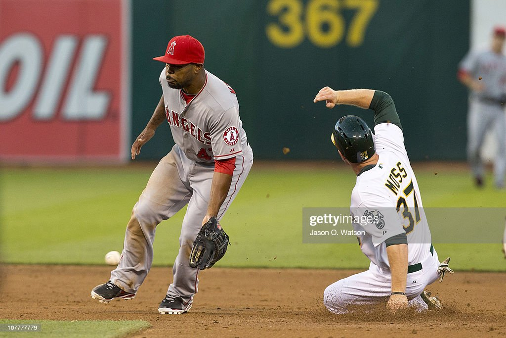 Brandon Moss #37 of the Oakland Athletics steals second base ahead of a throw to Howie Kendrick #47 of the Los Angeles Angels of Anaheim during the second inning at O.co Coliseum on April 29, 2013 in Oakland, California.