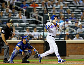 Brandon Nimmo of the New York Mets hits a three run home run in the fourth inning as Willson Contreras of the Chicago Cubs defends at Citi Field on...