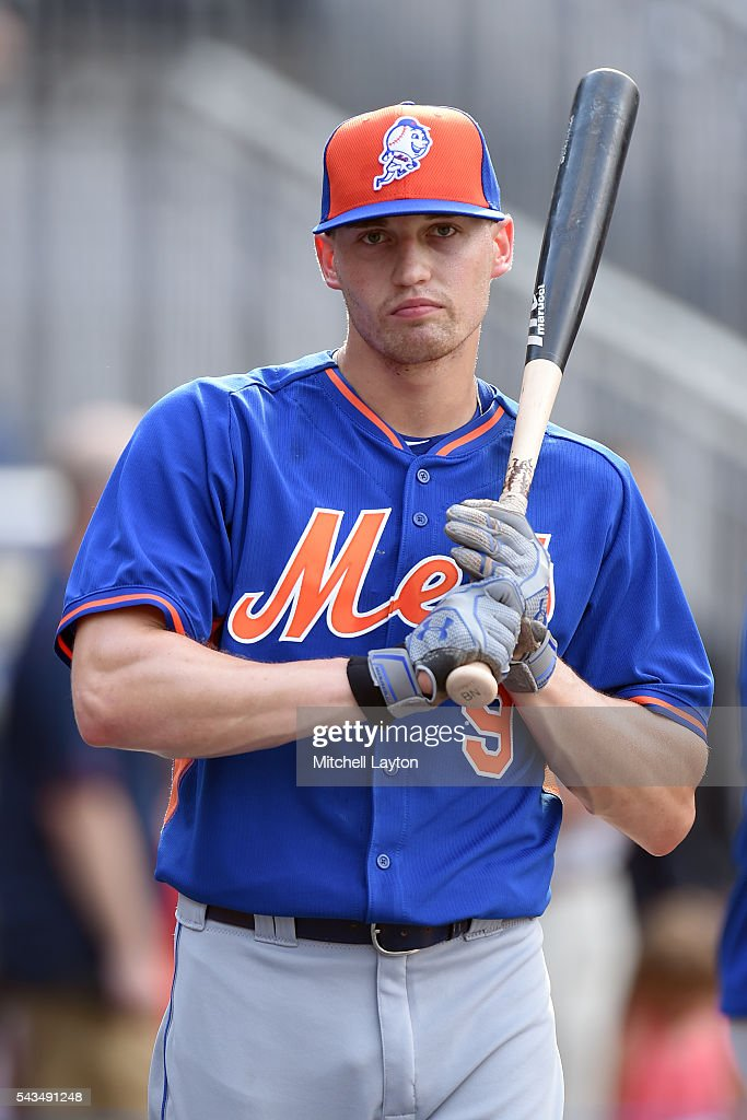 Brandon Nimmo #9 of the New York Mets looks on during batting practice of a baseball game against the Washington Nationals at Nationals Park on June 28, 2016 in Washington, DC.