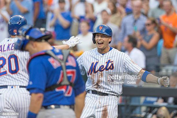 Brandon Nimmo of the New York Mets shows his delight on scoring off Neil Walker of the New York Mets two run first inning homer during the Chicago...