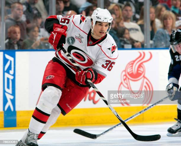 Brandon Nolan of the Carolina Hurricanes passes the puck against the Tampa Bay Lightning at St Pete Times Forum on December 22 2007 in Tampa Florida