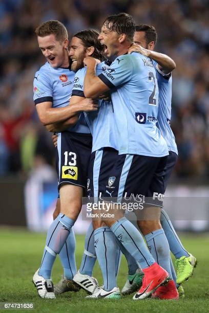 Brandon O'Neill Joshua Brillante and Filip Holosko of Sydney FC celebrate Joshua Brillante scoring a goal during the ALeague Semi Final match between...