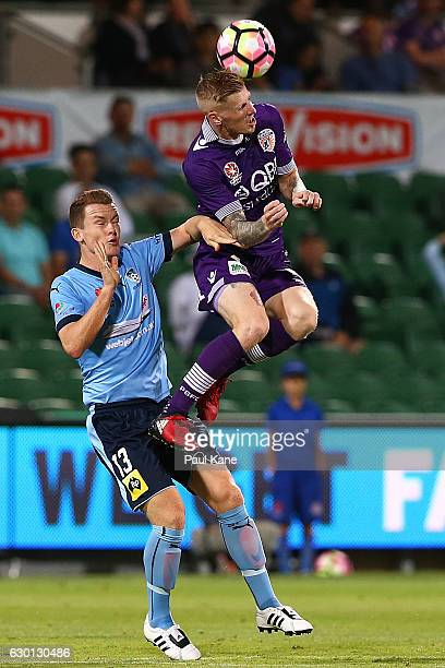 Brandon O'Neill of Sydney and Andy Keogh of the Glory contest a header during the round 11 ALeague match between Perth Glory and Sydney FC at nib...