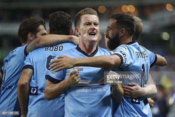 Brandon O'Neill of Sydney FC celebrates a goal scored by David Carney of Sydney FC during the round five ALeague match between Sydney FC and the...