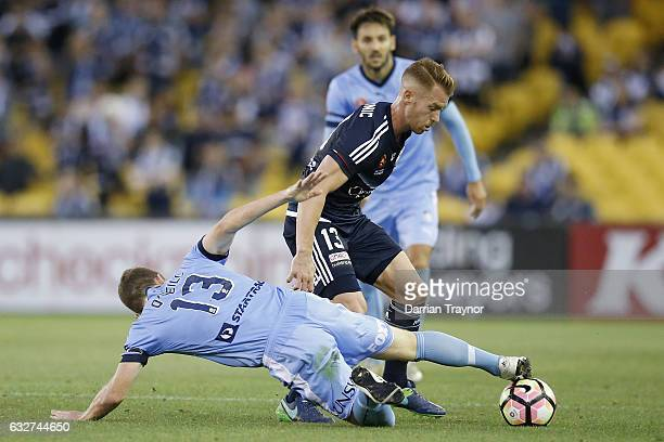 Brandon O'Neill of Sydney FC defends Oliver Bozanic of the Victory during the round 17 ALeague match between the Melbourne Victory and Sydney FC at...