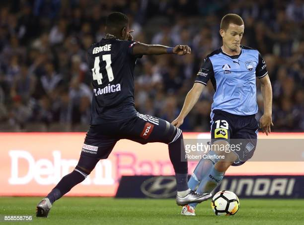Brandon O'Neill of Sydney FC is challenged by Leroy George of the Victory during the round one ALeague match between the Melbourne Victory and Sydney...