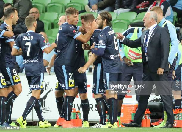 Brandon O'Neill of Sydney FC is congratulated by his teammates after scoring their second goal during the round 21 ALeague match between Melbourne...