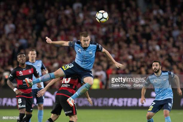 Brandon O'Neill of Sydney FC leaps over Wanderers Alvaro Cejudo during the round three ALeague match between Sydney FC and Western Sydney Wanderers...
